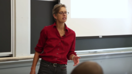 A photo of Professor Janet Rankin in front of her class