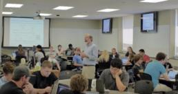 Professor Mark Andersland oversees group work